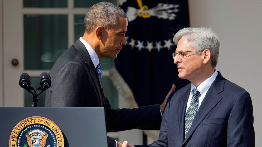 Federal appeals court judge Merrick Garland shakes hands with President Obama as he is introduced as Obama's nominee for the Supreme Court on March 16.