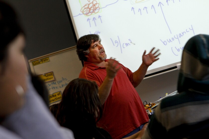Science teacher John Laird lectures in his classroom at Fedde Middle School in Hawaiian Gardens in 2011.