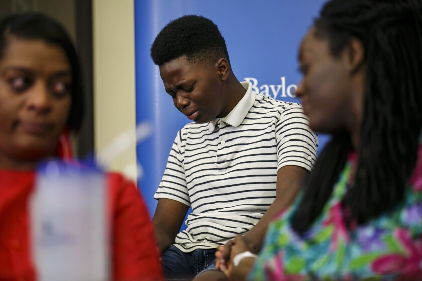 Jermar Taylor, 12, breaks down during a news conference July 10 in Dallas  as he recalls Thursday's shooting, which left his mother injured.