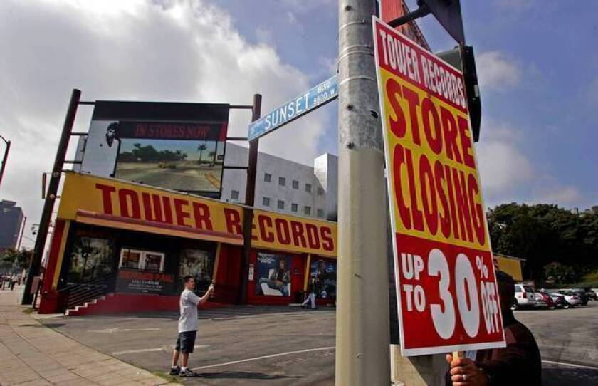 Lindsey Ikuta of Gardena snaps a photo of the Tower Records store in West Hollywood in 2006, the year the record store chain filed for bankruptcy. For six years, music fans have been hoping the West Hollywood Historic Preservation Commission would designate the building as a local cultural resource, a first step toward someday turning it into a museum.