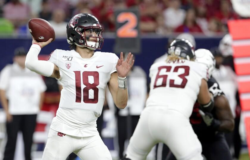 Washington State quarterback Anthony Gordon throws a pass
