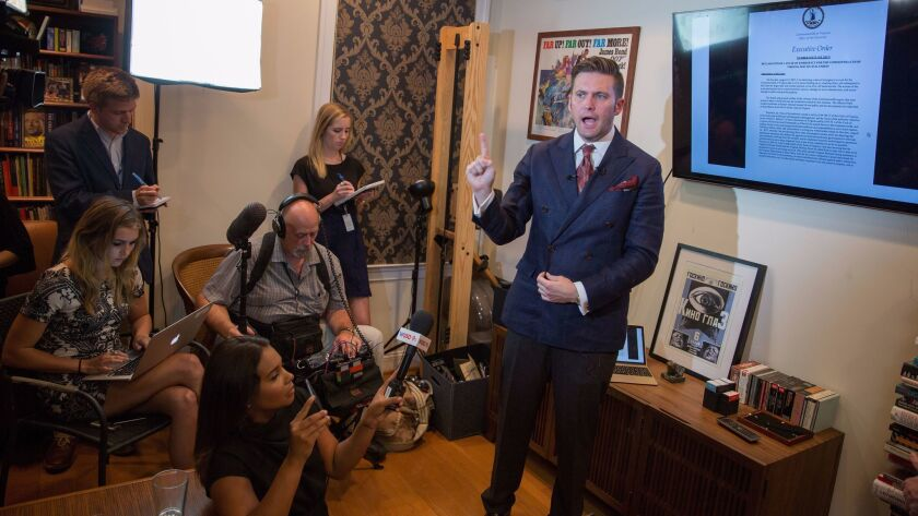 White nationalist Richard Spencer speaks to select media in his office space on Aug. 14, 2017, in Alexandria, Va.