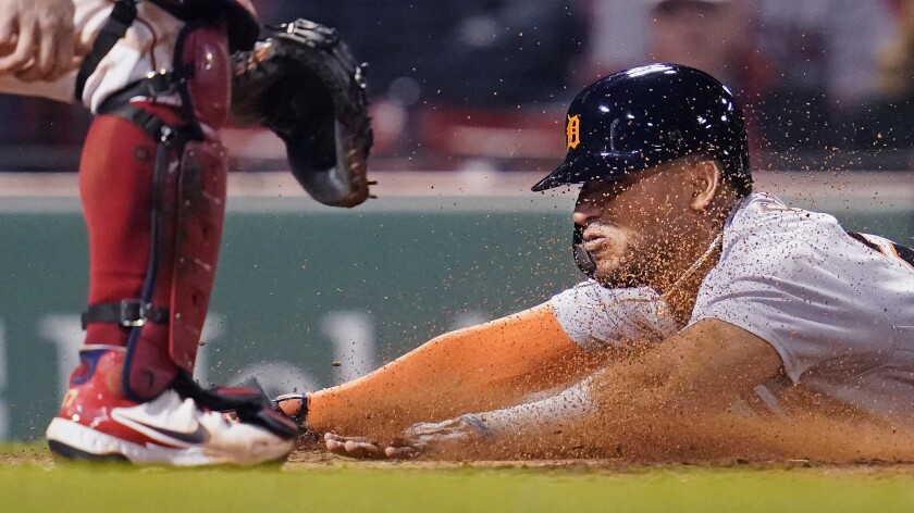 Detroit Tigers' Reyes slides head first into home while scoring on an RBI double by Robbie Grossman during the fifth inning of a baseball game against the Boston Red Sox at Fenway Park, Tuesday, May 4, 2021, in Boston. (AP Photo/Charles Krupa)