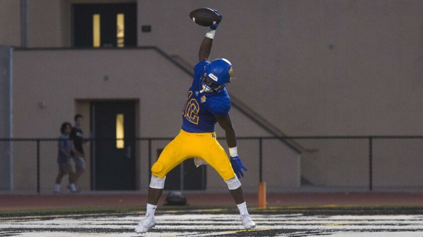 Fountain Valley High receiver Kishaun Sykes, shown celebrating a score on Aug. 16, has at least one touchdown catch in each of the Barons' first three games.