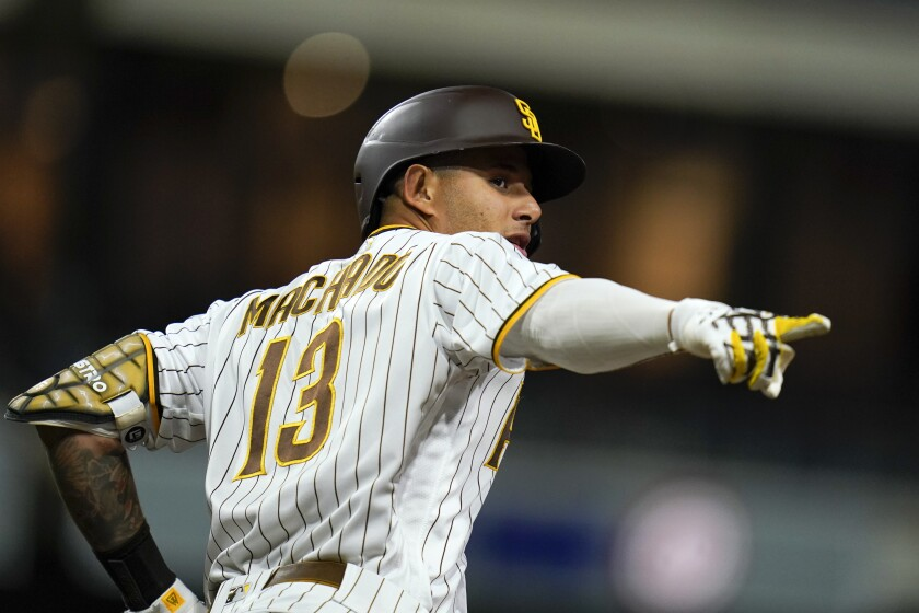 San Diego Padres' Manny Machado reacts after hitting a home run during the eighth inning of a baseball game against the Chicago Cubs, Monday, June 7, 2021, in San Diego. (AP Photo/Gregory Bull)