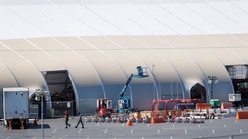 The Tesla tent under construction June 20. Model 3 body frames are fork-lifted from the main factory to a new assembly line the company said it has built inside.
