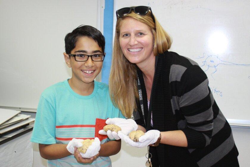 Cameron Eslamian and Torrey Pines Elementary School principal Sarah Ott with actual sheep brains