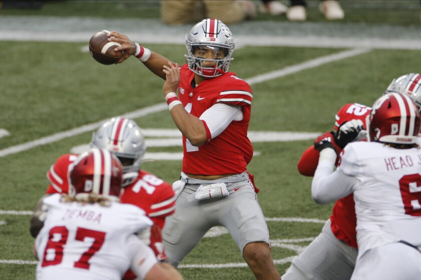 Ohio State quarterback Justin Fields throws a pass against Indiana during the first half of an NCAA college football game Saturday, Nov. 21, 2020, in Columbus, Ohio. (AP Photo/Jay LaPrete)