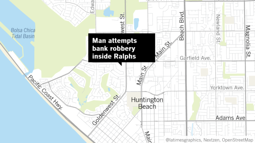 A man was arrested Wednesday on suspicion of trying to rob a Wells Fargo bank branch inside a supermarket in the 19000 block of Goldenwest Street in Huntington Beach, police said.