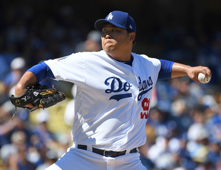 Hyun-Jin Ryu #99 of the Los Angeles Dodgers pitches in the second inning of the game against the San Diego Padres at Dodger Stadium on September 23, 2018 in Los Angeles, California.