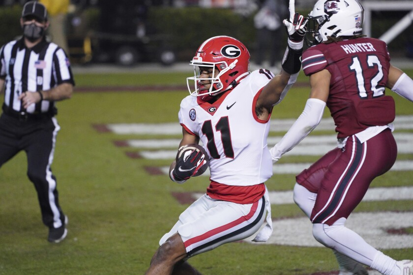 Georgia wide receiver Arian Smith (11) scores a touchdown during the second half of the team's NCAA college football game against South Carolina on Saturday, Nov. 28, 2020, in Columbia, S.C. Georgia won 45-16. (AP Photo/Sean Rayford)