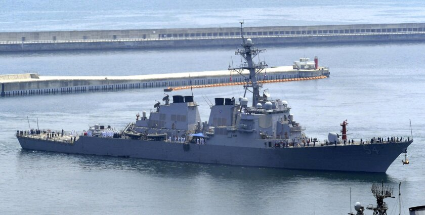 FILE - In this June 4, 2010, file photo, the USS Curtis Wilbur arrives at a naval base in Busan, South Korea, for South Korea-U.S. joint drills. China strongly condemned the United States after the missile destroyer deliberately sailed near one of the Beijing-controlled islands in the hotly contested South China Sea to exercise freedom of navigation and challenge China's vast territorial claims. (Jo Jong-ho/Yonhap via AP) KOREA OUT
