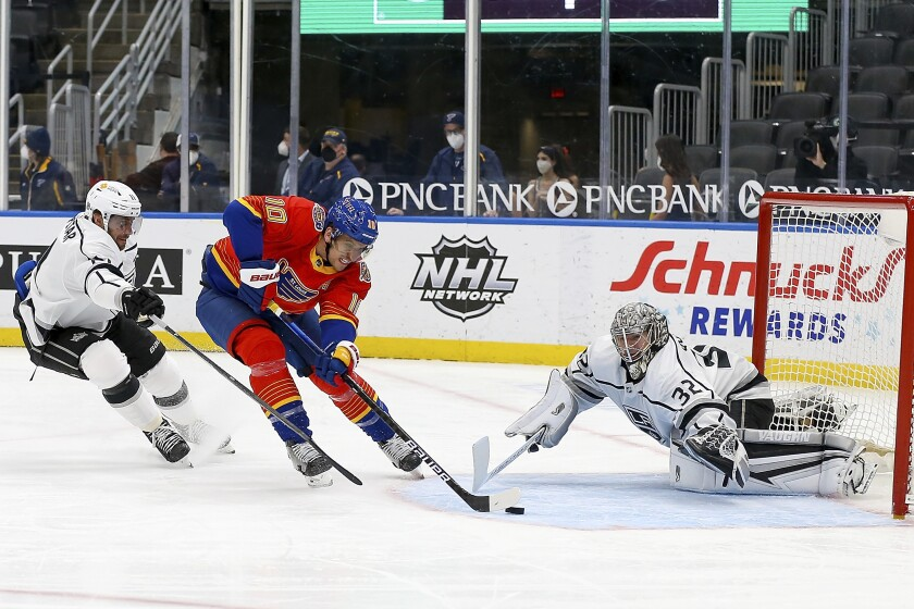 St. Louis Blues' Brayden Schenn is unable to score as Kings' goaltender Jonathan Quick and Anze Kopitar defend.