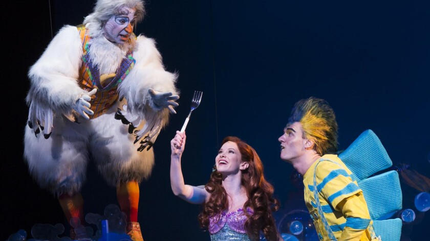 """Jamie Torcellini as Scuttle, Alison Woods as Ariel and Adam Garst as Flounder in """"The Little Mermaid"""" at La Mirada Theatre for the Performing Arts."""