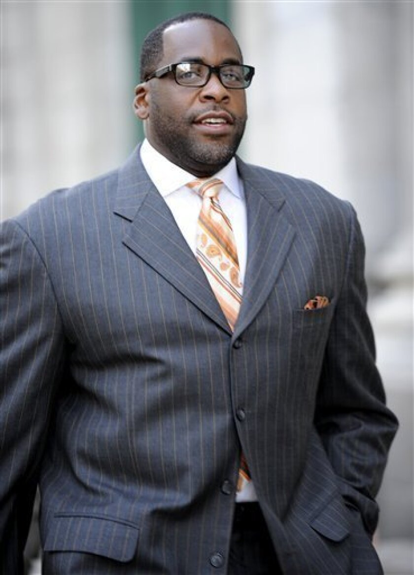 """FILE - In this Sept. 27, 2012 file photo, former Detroit mayor Kwame Kilpatrick makes his way to U.S. Federal Court in Detroit. Businessman Karl Kado, who held contracts at Detroit's convention center, said Monday, Dec. 3, 2012 that he was a """"hostage"""" who felt compelled to pay thousands of dollars to then-Mayor Kwame Kilpatrick and his father or lose work. Kado told jurors that he personally delivered $5,000 to $10,000 to Kilpatrick """"three or four times."""" He said he also delivered money through a top mayoral aide and separately paid $200,000 to $300,000 to Kilpatrick's father, Bernard. Kado is a crucial witness at the corruption trial, which began in September. (AP Photo/The Detroit News, David Coates)"""