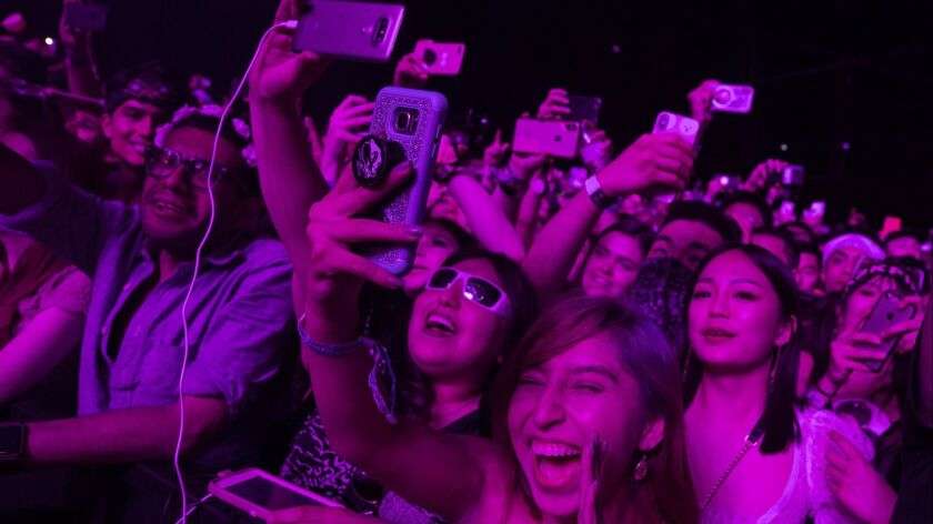 INDIO, CALIF. -- FRIDAY, APRIL 12, 2019: Fans watch BLACKPINK on the Sahara stage at the Coachella