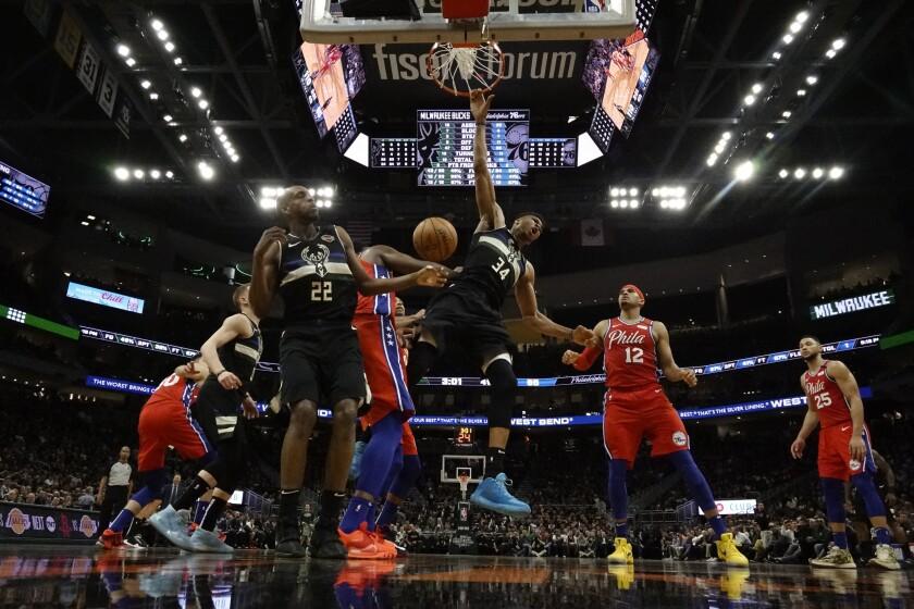 Milwaukee Bucks' Giannis Antetokounmpo reacts as he dunks during the second half of an NBA basketball game against the Philadelphia 76ers Thursday, Feb. 6, 2020, in Milwaukee. The Bucks won 112-101. (AP Photo/Morry Gash)