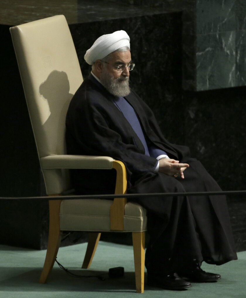 Iranian President Hassan Rouhani sits on the head of state chair after addressing the 70th session of the United Nations General Assembly at U.N. headquarters, Monday, Sept. 28, 2015. (AP Photo/Mary Altaffer)