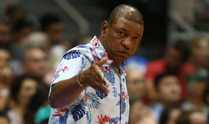 Clippers coach Doc Rivers gestures to his players during an exhibition game against the Sydney Kings on Sept. 30 in Honolulu.