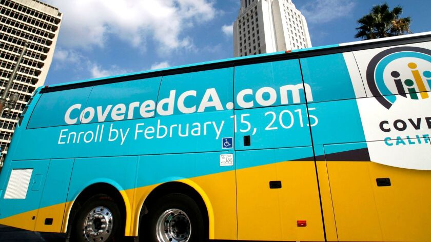 A Covered California bus departs Grand Park, in front of Los Angeles City Hall, on November 14, 2014.