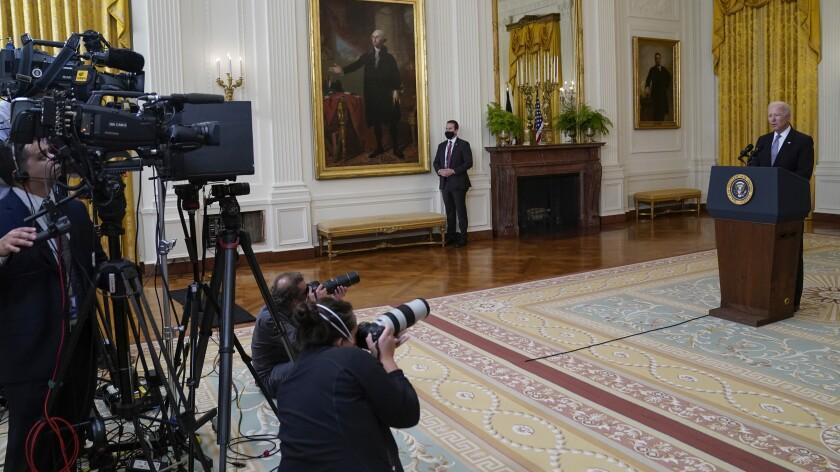 President Joe Biden with first lady Jill Biden waves as they walk near White House and board Marine One Saturday