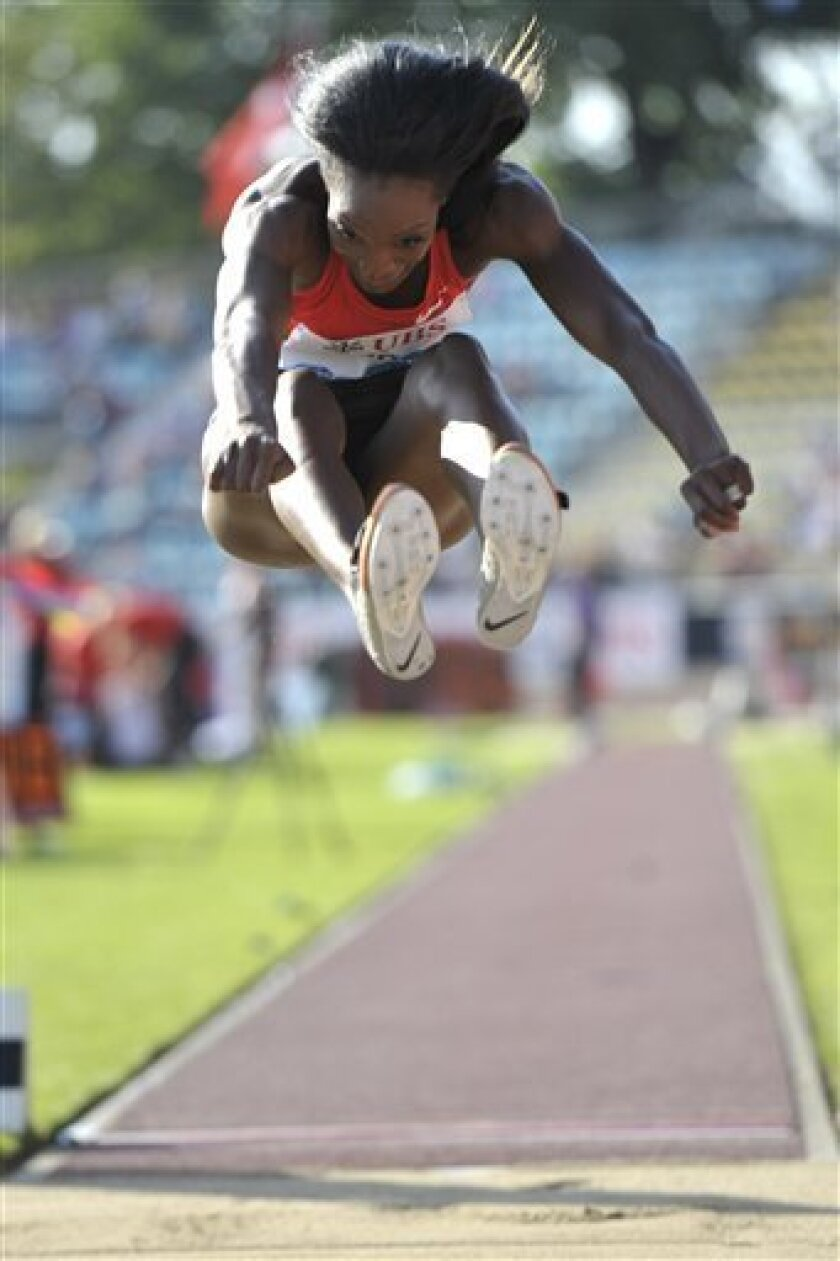 Funmi Jimoh, from the USA, in action during the long jump event at the Athletissima IAAF Diamond League international athletics meeting in the Stade Olympique de la Pontaise in Lausanne, Switzerland, on Thursday June 30, 2011.  (AP Photo/Keystone, Dominic Favre) GERMANY AND AUSTRIA OUT