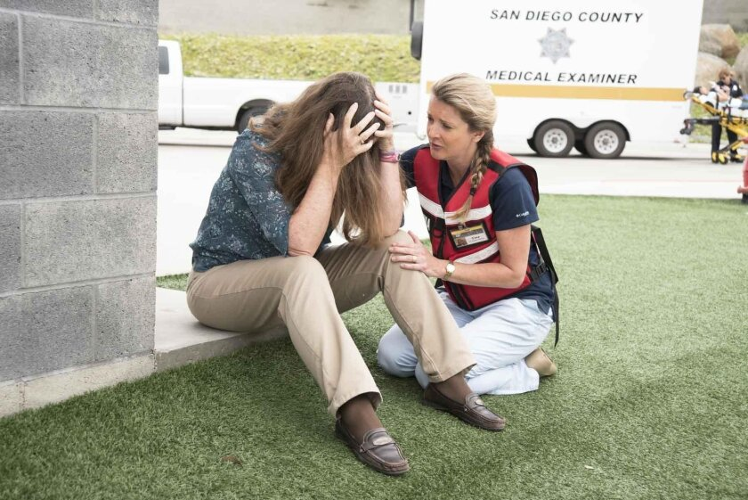 Trauma Intervention Programs of San Diego volunteers Pam Lyons and Tina Stefanik going through a role-playing exercise during a recent training session.