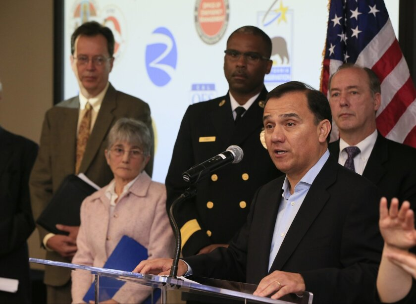 SoCalGas CEO Dennis Arriola, second from right, takes questions from the media Thursday, Feb. 18, 2016, during the announcement that the Porter Ranch gas leak has been permanently sealed during a news conference in Chatsworth, Calif., on Thursday, Feb. 18, 2016. The announcement certifying that the