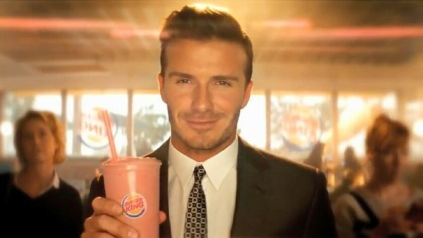 David Beckham shills for Burger King following a major shift in the fast-food chain's advertising strategy.