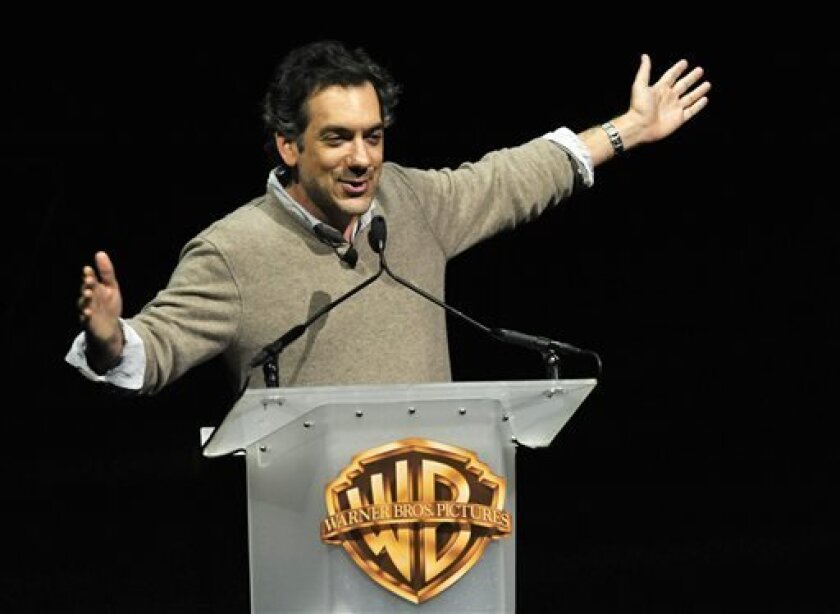 """Todd Phillips, director of the forthcoming film """"The Hangover Part III,"""" addresses the audience during the Warner Bros. presentation at CinemaCon 2013 at Caesars Palace on Tuesday, April 16, 2013 in Las Vegas. (Photo by Chris Pizzello/Invision/AP)"""