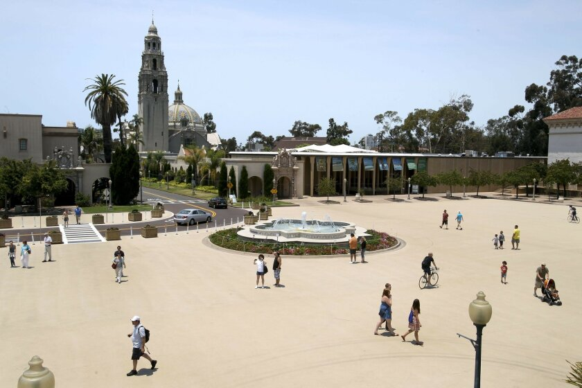 People walk across the Plaza de Panama, which is now closed to cars, at Balboa Park in San Diego on Saturday.