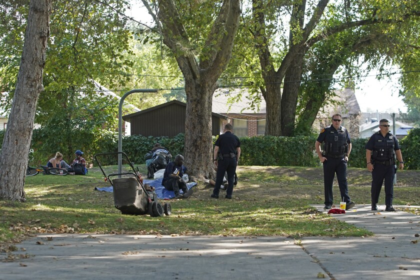 Salt Lake City police in a park where homeless people tend to camp.
