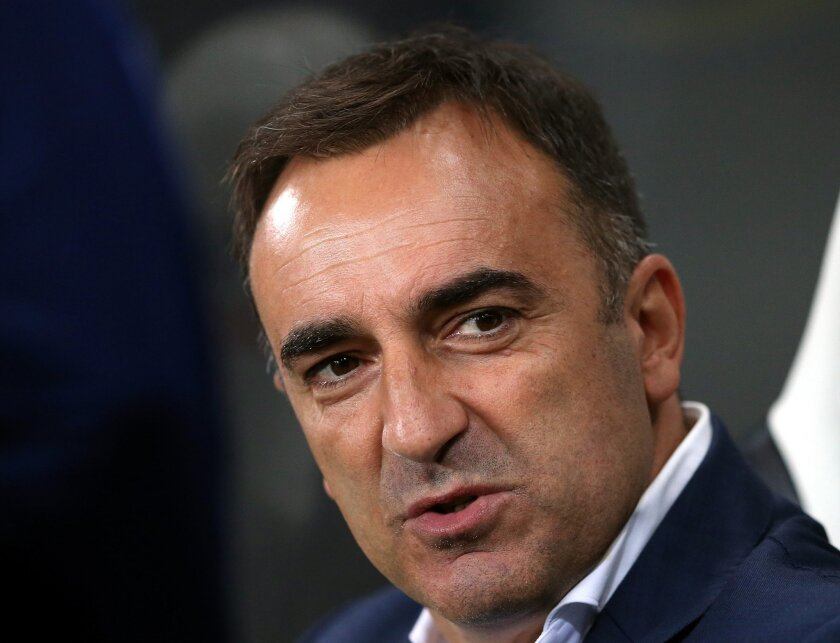 FILE - This is a Wednesday, Sept. 23, 2015 file photo of Sheffield Wednesday's manager Carlos Carvalhal as he awaits the start of the English League Cup third round soccer match between Newcastle United and Sheffield Wednesday at St James' Park, Newcastle, England.  Sheffield Wednesday will play Hu