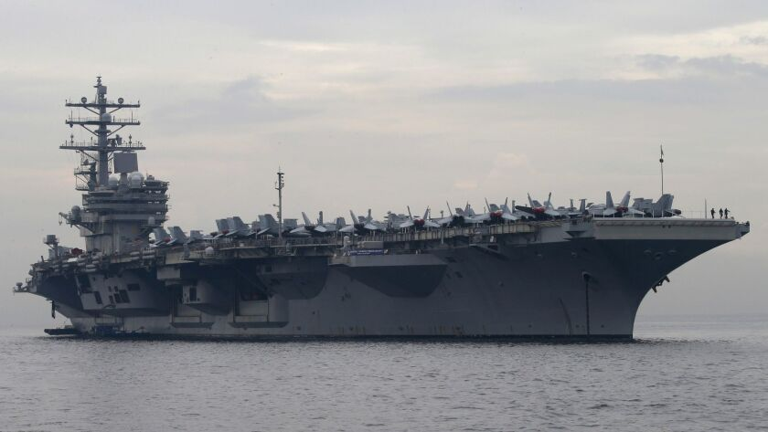 FILE- In this June 26, 2018, file photo, the U.S. aircraft carrier USS Ronald Reagan anchors off Man