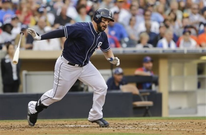 San Diego Padres' Yonder Alonso tosses his bat after he grounds out in the fourth inning of a baseball game against the Chicago Cubs, Saturday, Aug. 24, 2013, in San Diego. (AP Photo/Lenny Ignelzi)