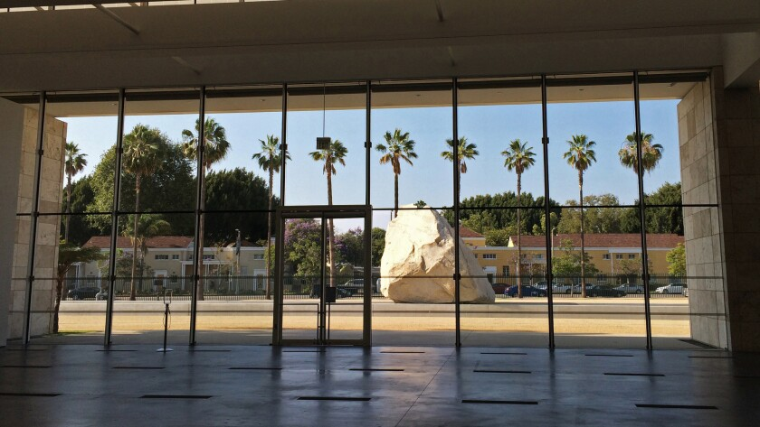 "For three years, Michael Heizer's megalith sculpture ""Levitated Mass"" has sat in a specially designed courtyard at LACMA. But the best view of it is from indoors."