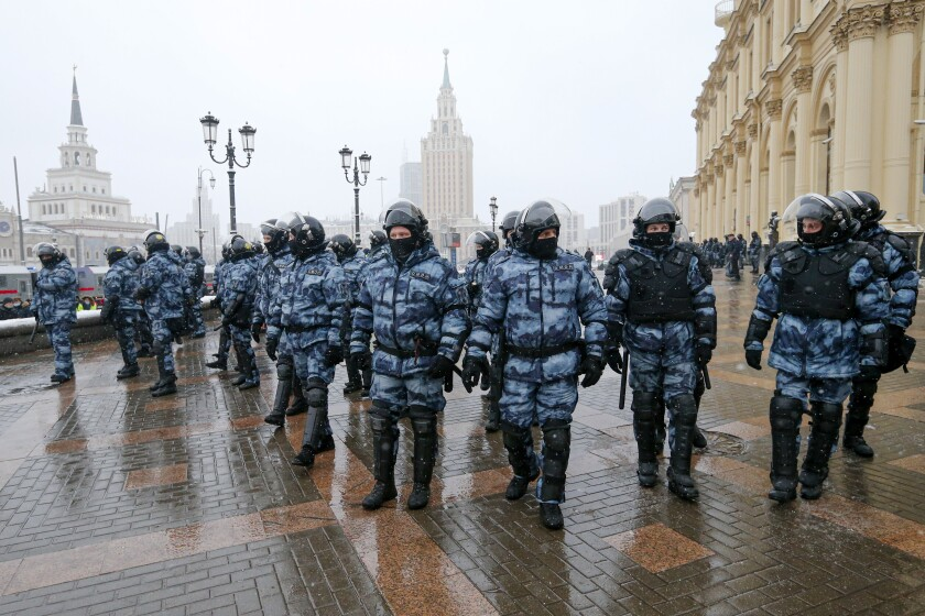 Riot police block an area protecting against demonstrators during a protest against the jailing of opposition leader Alexei Navalny in Moscow, Russia, Sunday, Jan. 31, 2021. Thousands of people took to the streets Sunday across Russia to demand the release of jailed opposition leader Alexei Navalny, keeping up the wave of nationwide protests that have rattled the Kremlin. Hundreds were detained by police. (AP Photo/Alexander Zemlianichenko)