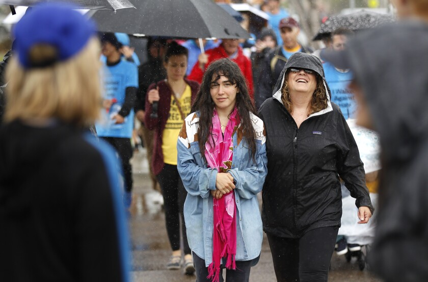 Hannah Kaye, left, walks with Michelle Silverman during the 2nd annual Walk Against Hate on Sunday, which raised money for the Anti-Defamation League's programs. Kaye is the daughter of Lori Gilbert-Kaye, who was killed in a shooting at the Chabad of Poway. A group of Lori's friends formed a team to participate in the walk in Liberty Station.