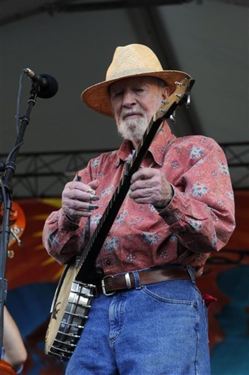 Pete Seeger performs at the New Orleans Jazz and Heritage Festival, Saturday, April 25, 2009 in New Orleans. The festival features hundreds of acts on 12 stages this weekend and next. The festival will continue Sunday and pick up again on Thursday. Among this year's headline acts are Bon Jovi, Neil Young, Kings of Leon and Sugarland. (AP Photo/Cheryl Gerber)
