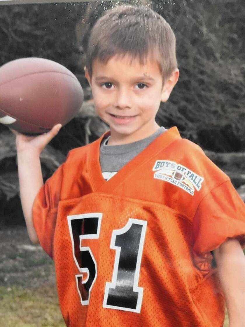 Brock McCann was identified by authorities Friday as the 8-year-old boy who was struck and killed by a trash truck in Newport Beach on Wednesday.