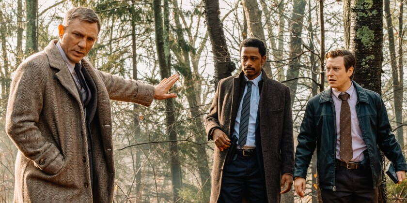 "Daniel Craig, Lakeith Stanfield and Noah Segan in the movie ""Knives Out."""