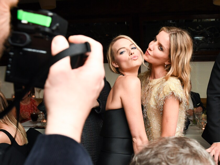 Margot Robbie, left, and Annabelle Wallis
