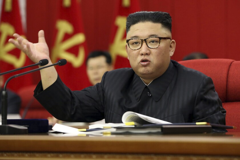 In this photo provided by the North Korean government, North Korean leader Kim Jong Un speaks during a Workers' Party meeting in Pyongyang, North Korea, Tuesday, June 15, 2021. Kim warned about possible food shortages and called for his people to brace for extended COVID-19 restrictions as he opened a major political conference to discuss national efforts to salvage a broken economy. the North's official Korean Central News Agency said Wednesday, June 16, 2021. Independent journalists were not given access to cover the event depicted in this image distributed by the North Korean government. The content of this image is as provided and cannot be independently verified. (Korean Central News Agency/Korea News Service via AP)