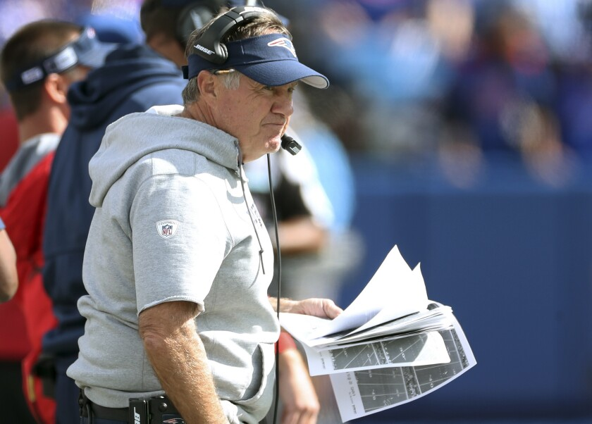 New England Patriots head coach Bill Belichick watches from the sideline in the first half of an NFL football game against the Buffalo Bills, Sunday, Sept. 29, 2019, in Orchard Park, N.Y. (AP Photo/Ron Schwane)