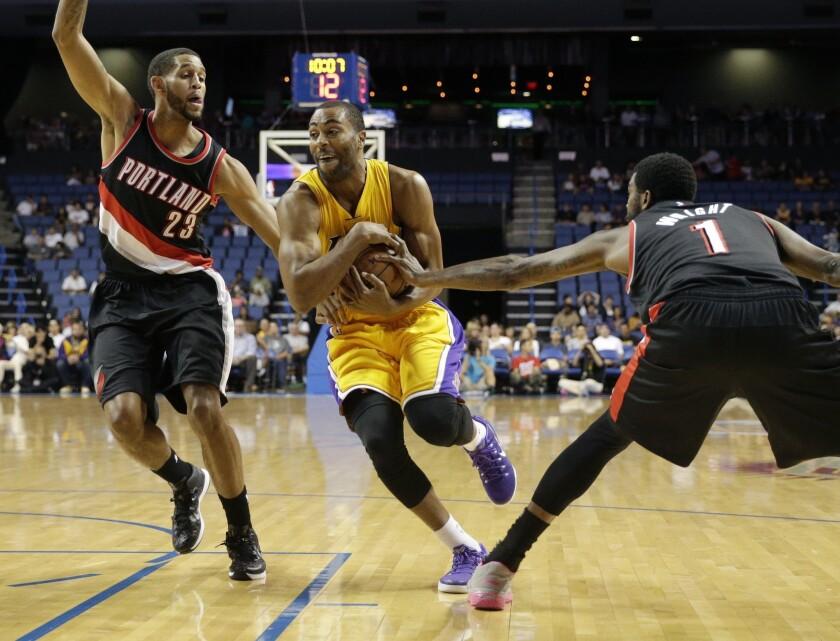 Lakers guard Wayne Ellington, center, has taken an indefinite leave of absence after his father, Wayne Ellington Sr., was fatally shot in Philadelphia on Sunday.