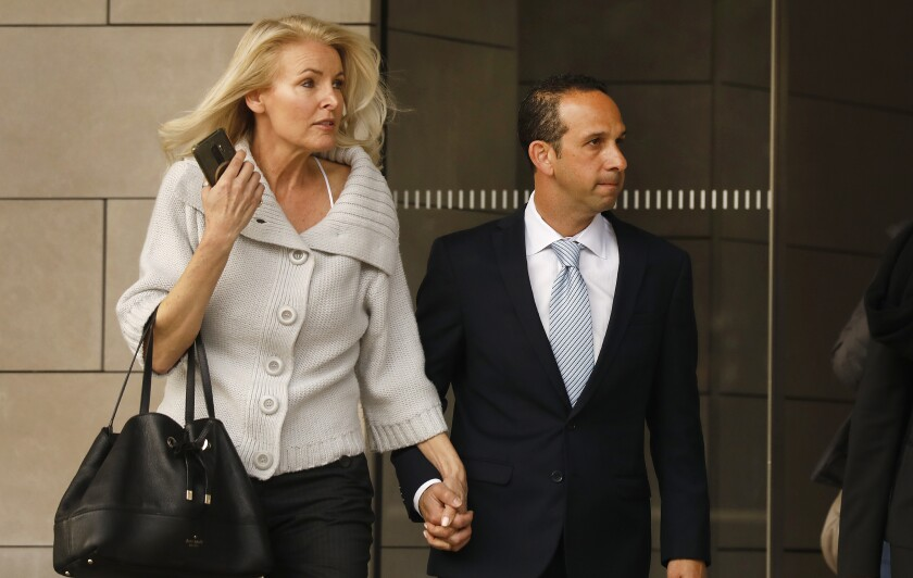 Mitchell and Jayne Englander clasp hands as they walk.