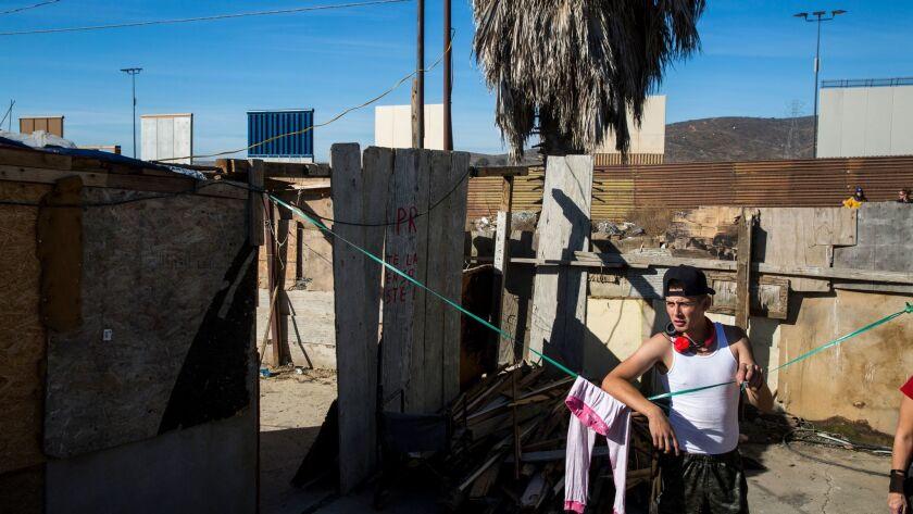 TIJUANA, B.C., MEX - FEBRUARY 01: Alexis Franco Santana's house is right along the border fence; pho