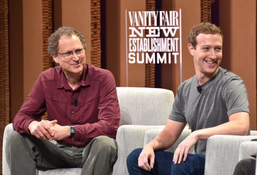 Oculus chief scientist Michael Abrash and Facebook CEO Mark Zuckerberg take part in the Vanity Fair New Establishment Summit at the Yerba Buena Center for the Arts in San Francisco on Oct. 7.