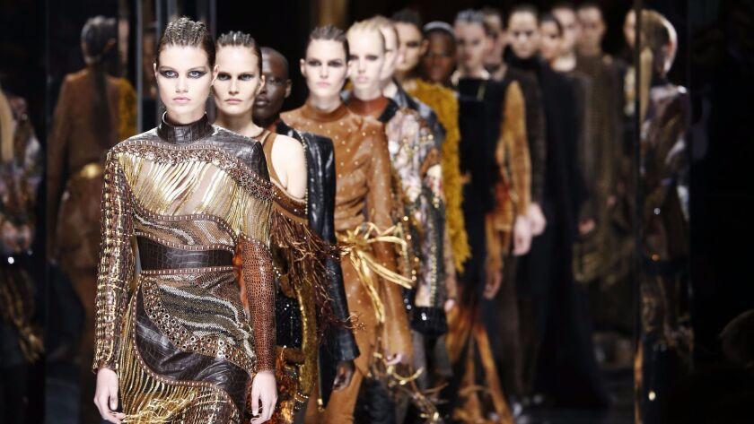Mandatory Credit: Photo by WWD/REX/Shutterstock (8450824m) Models on the catwalk Balmain show, Runwa