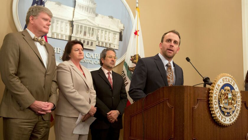 Assemblyman Marc Levine, D-San Rafael, right, discusses the bill that he, Assemblyman Mark Stone, D-
